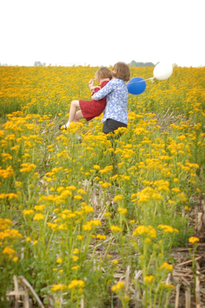 Hanna and her mom in a field of wild mustard