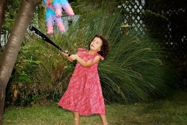 Leah swings at the pinata