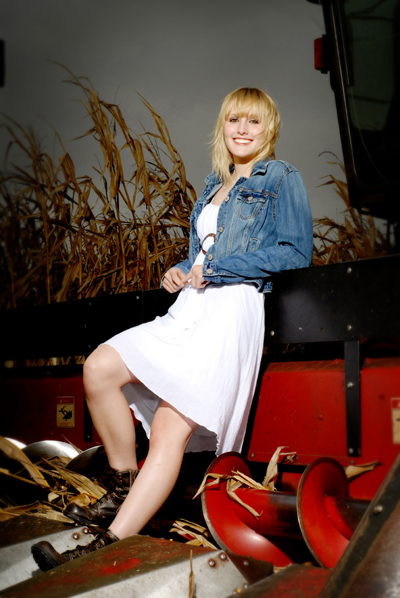 Senior portrait on a combine