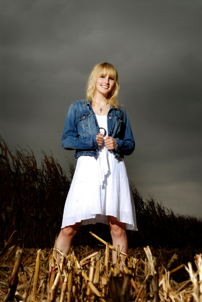 Senior portrait in a cornfield
