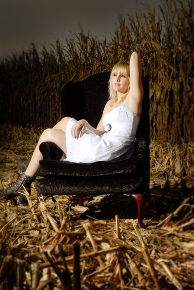 Senior , velvet chair and cornfield