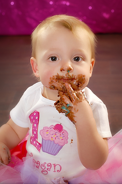 photo of baby and cake