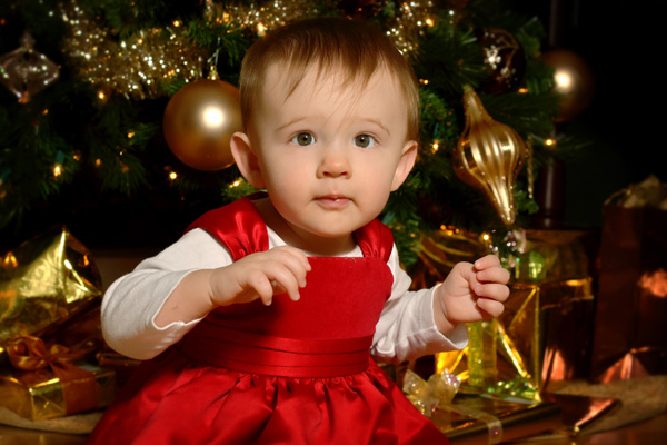 baby photos under the Christmas tree