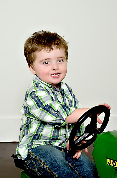 Photo of little boy on tractor