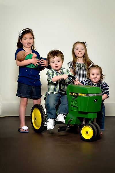 portraits of grandchildren on tractor