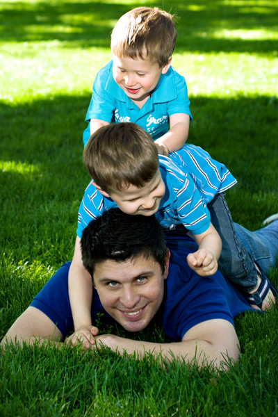 action photos of dad and boys