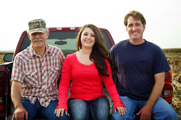 Senior picture with dad and grampa in a pickup truck