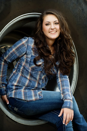 Senior picture in a tractor tire