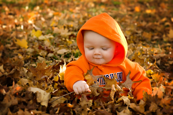 9 month old in the leaves
