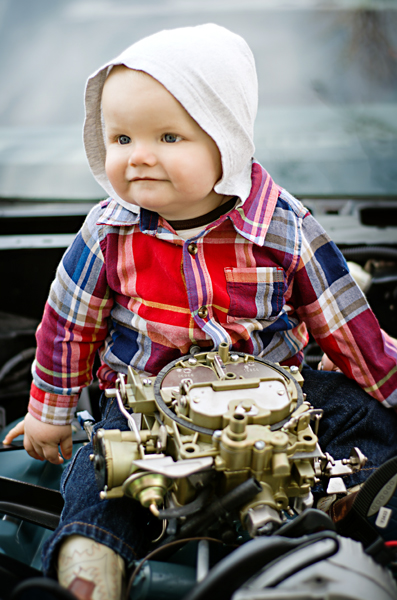 9 month old on a vintage car