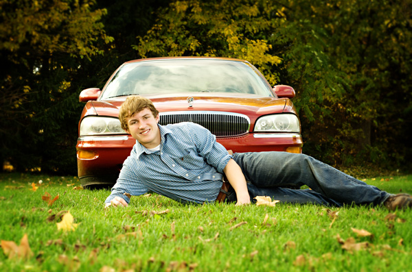 Portrait of a senior with his car