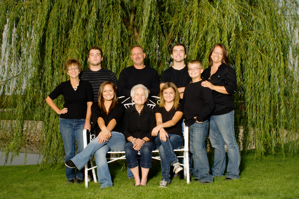family photo in front of weeping willow
