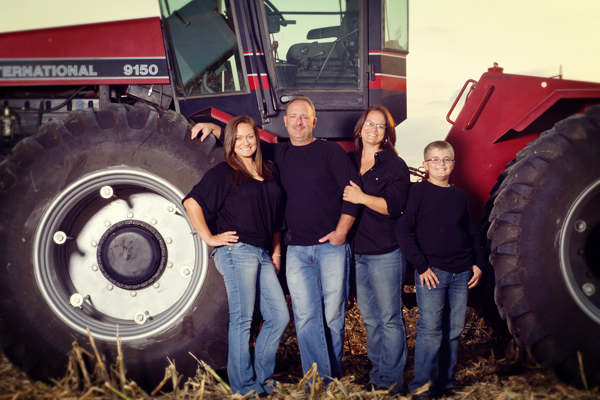Family photos in front of the tractor