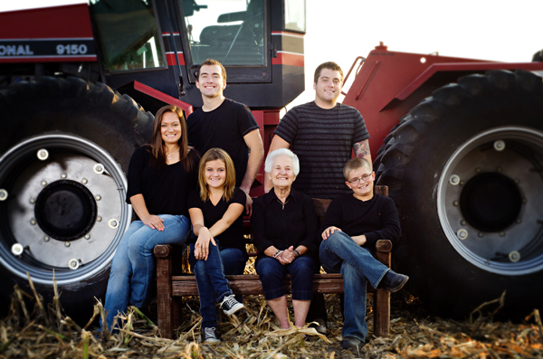 farm family photos - grandkids in front of the red tractor