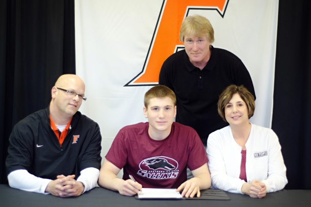 Fisher Football Player signs to SIU photo by Laura Trovillion Photography