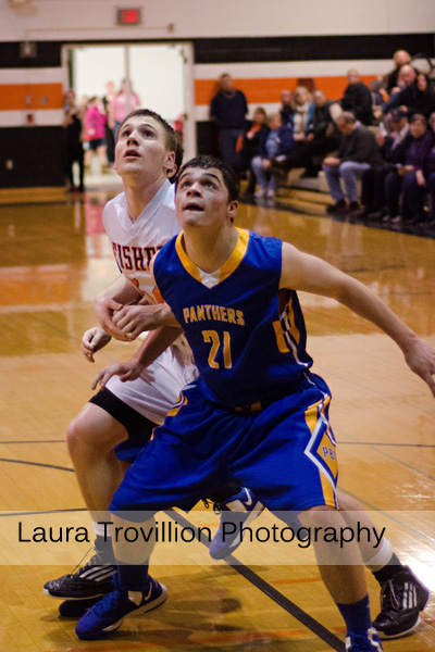 High school boys basketball action photo