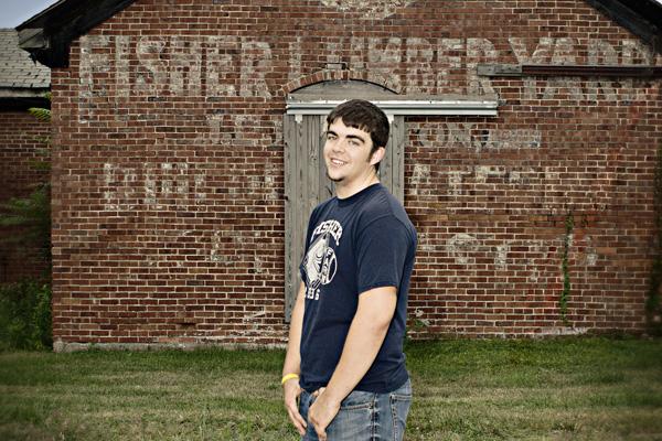 2014 senior boy with vintage building