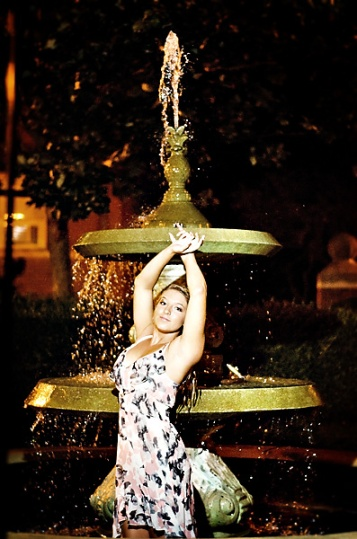 Senior girl in fountain