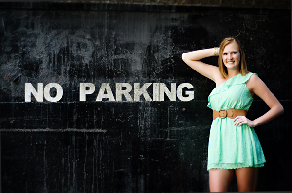Senior Girl in front of no parking sign