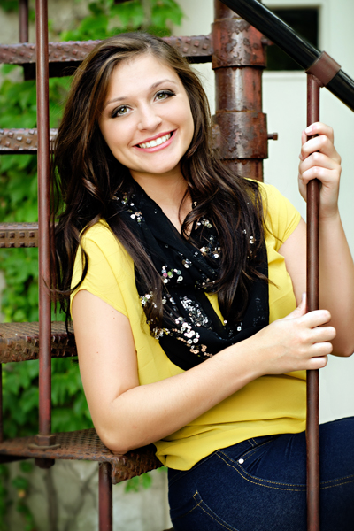 Senior girl on circular staircase