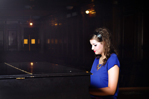 senior girl with a piano