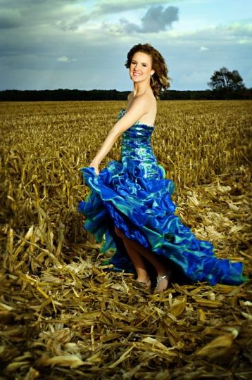 senior girl in prom dress in cornfield