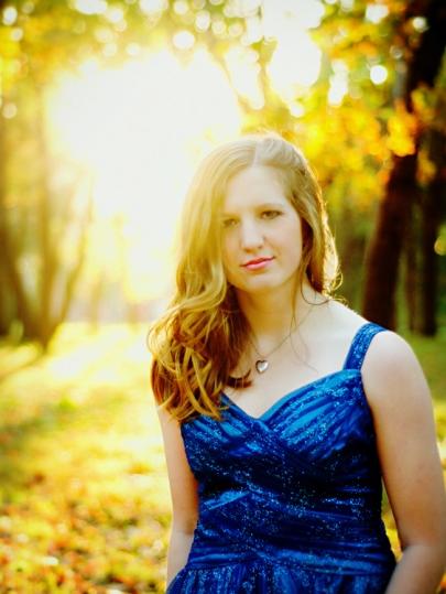 Senior portrait with golden backlight