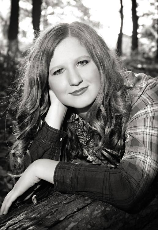 Senior girl on  a log