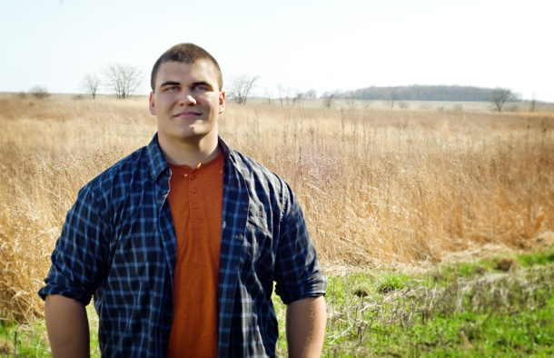 2014 senior boy in a prairie restoration