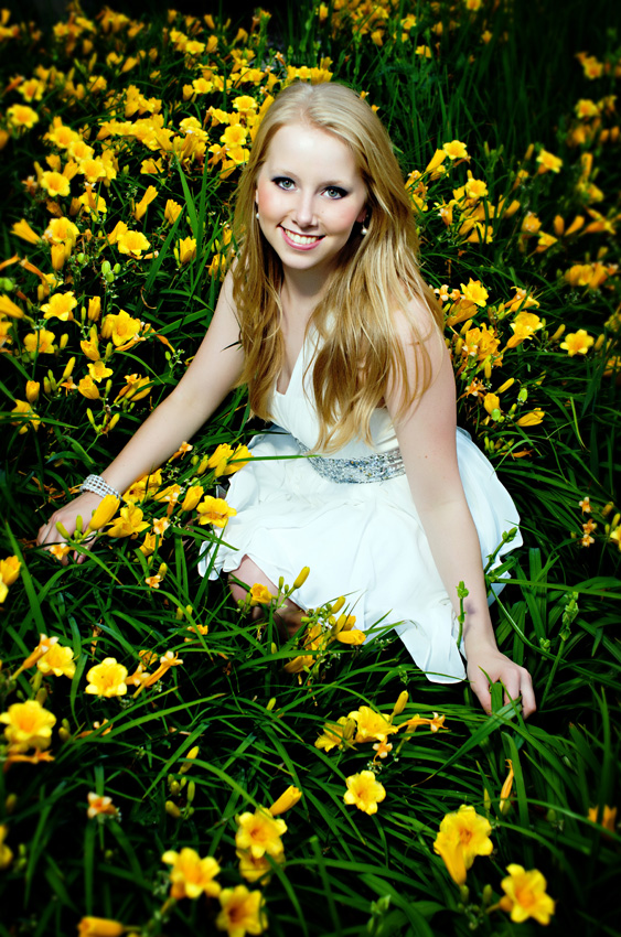 senior girl in field of flowers