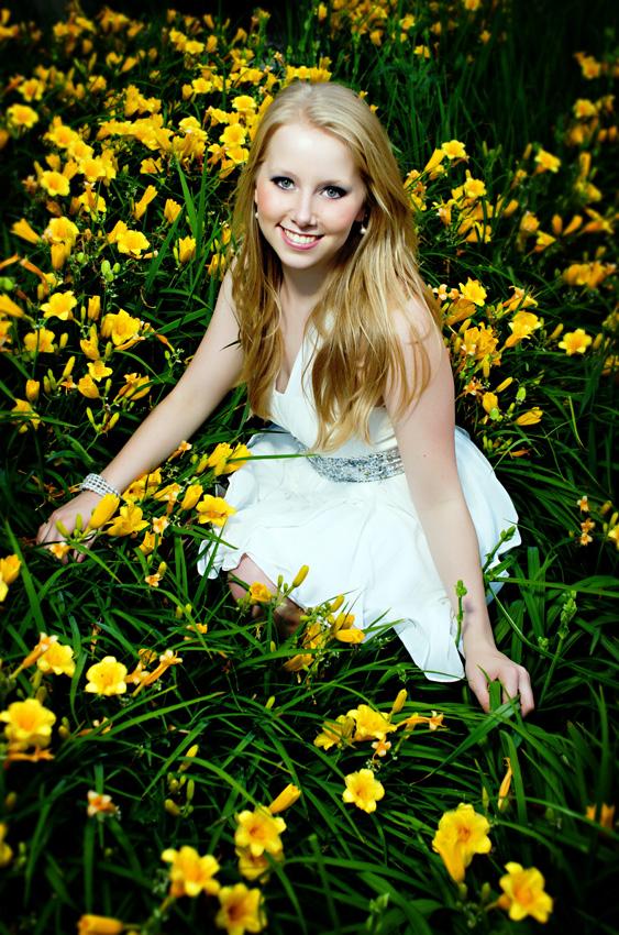 senior girl in field of flowers