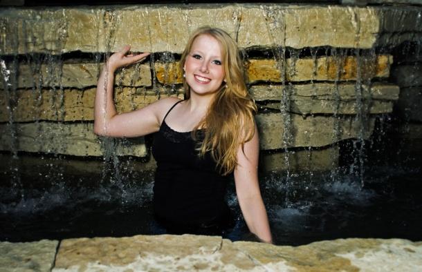 senior girl in waterfall
